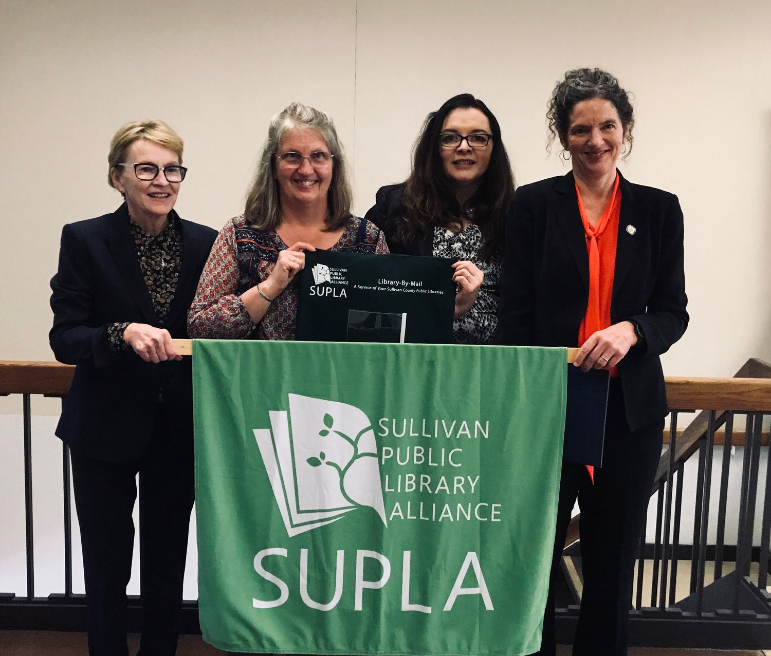 Assemblywoman Aileen Gunther, SUPLA President Mary Paige Lang Clouse, RCLS Executive Director Grace Riario and Sen. Jen Metzger announce a new library-by-mail service.