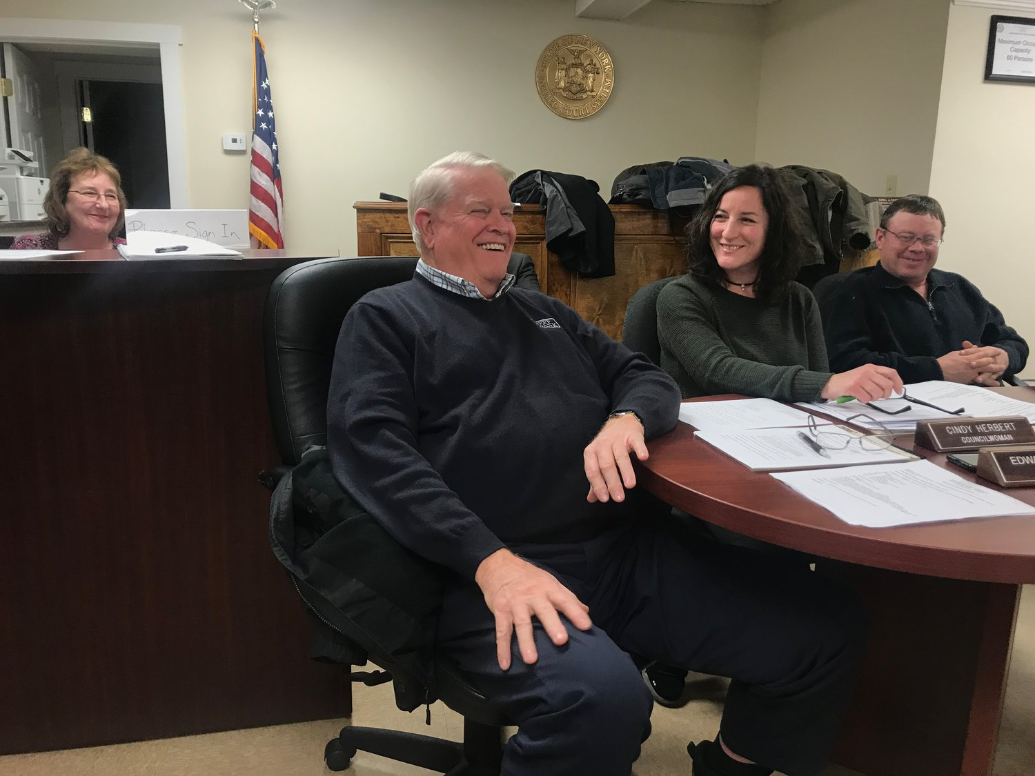 Ed Sykes shares a final laugh with Town Clerk Tess McBeath, left, councilwoman Cindy Herbert, right, and councilman Christopher Hermann.