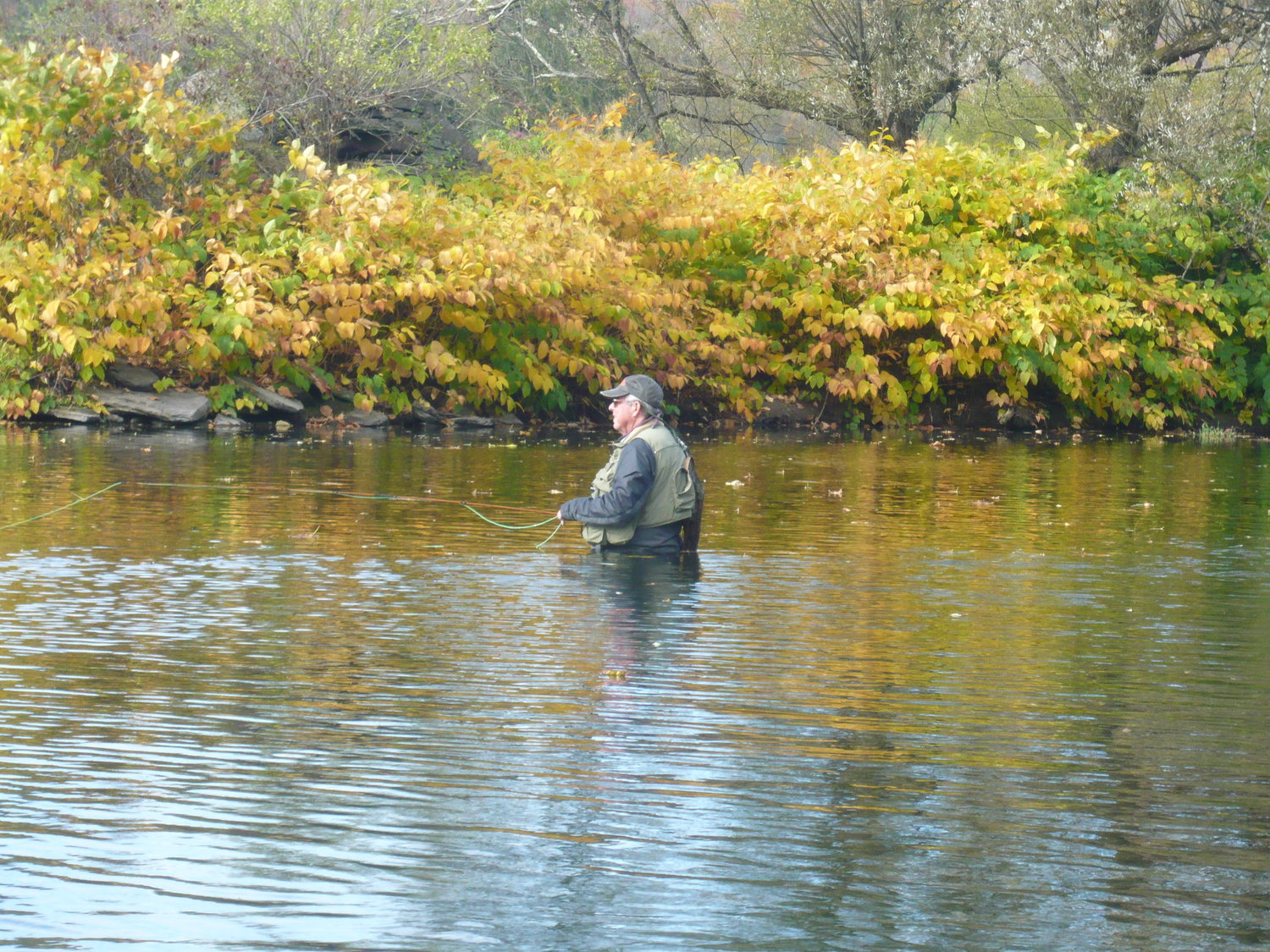 An angler fishing across and downstream.