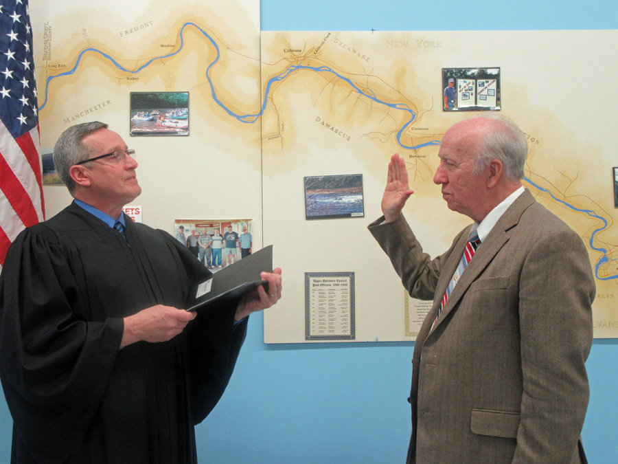 The Honorable Steven Sauer, Town of Cochecton Town Justice, left, swears in Larry H. Richardson as 2020 chairperson of the Upper Delaware Council.