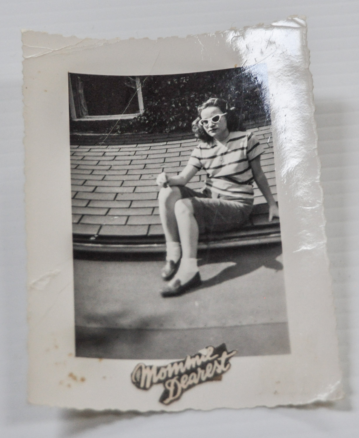 "Mom may have been named after Barbara Stanwyck and Joan Crawford, but the words ""Mommy Dearest"" attached to this classic photo of her on the roof at 15? She was ""less than thrilled."""