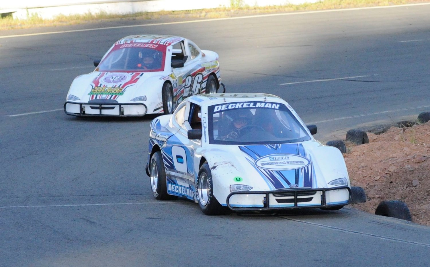 In the lead. Monika Deckelman holds off 12-year-old Leland Oefelein-Brush in car #26 during a series of practice laps.