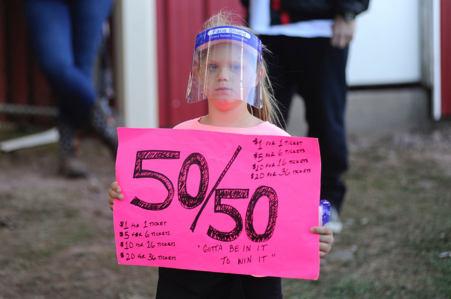Winner takes all: the 50-percent version. Nine-year-old Charlotte Crane of Montgomery, NY works the crowd selling 50/50 tickets. He dad, Andy, is the track's co-announcer, promoter and veteran racecar driver.