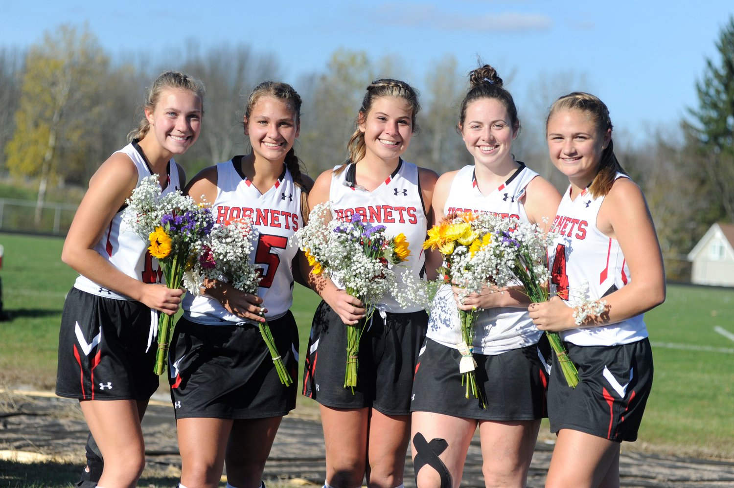 We are the seniors! Honesdale's senior field hockey scholar-athletes played their final home game at the Home of the Hornets. Pictured are Leah Krol (scored the second goal of the match), left, Gina Dell'Aquila, Brynn McGinnis, co-captain Grace Maxson and co-captain Sarah Meyer, who posted her team's first goal.