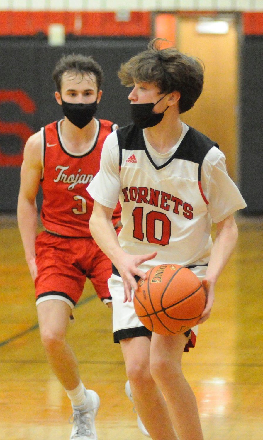 Searching for a score. Honesdale's junior guard Karter Kromko scored 9 points, all 3-pointers. He is challenged on the court by North Pocano's Zack Walsh, who posted 12 points, including two 3-pointers.