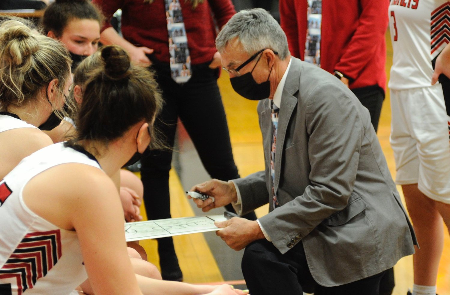 Listen up!  Honesdale's coach Ron Rowe calls a time out to discuss strategy with the Lady Hornets.