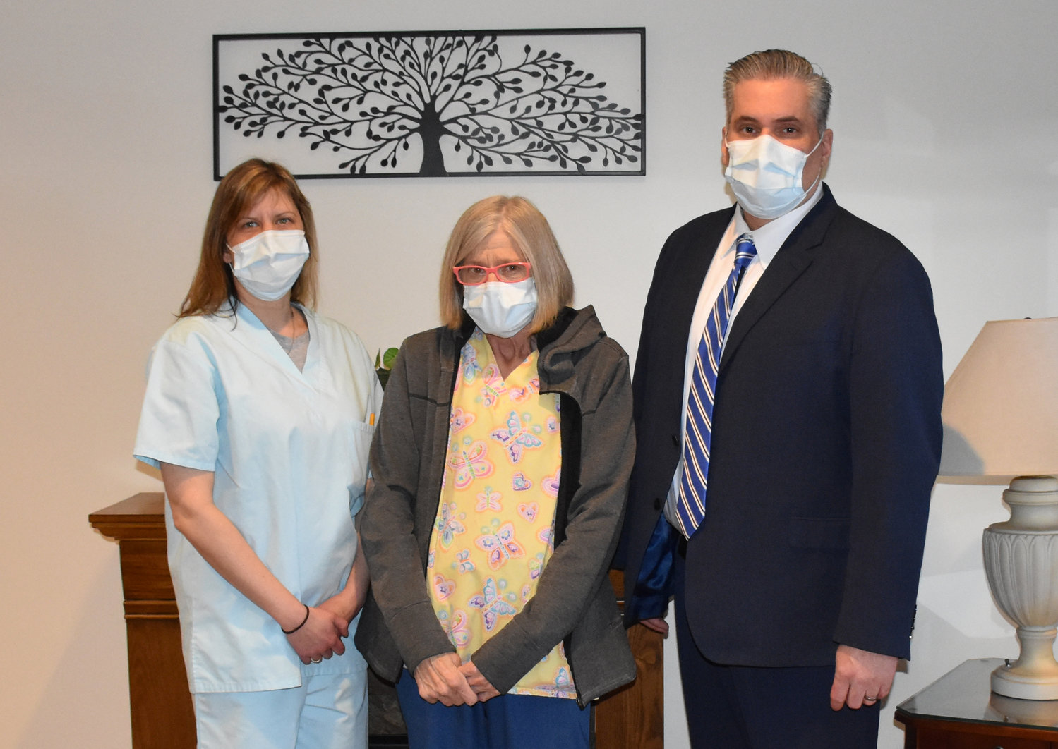 Wayne Woodlands Manor Employee of the Year 2020 Kathy Piorkowski, RN, is flanked by director of nursing Kelly Miller, RN, left, and Wayne Woodlands Administrator Michael Freund.