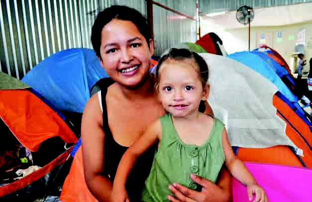 Honduran immigrant Belkis Yanely Bucto Buezo holds her