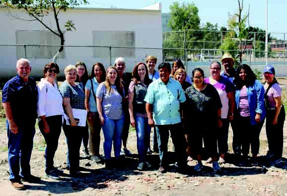 DOM Mike Carlisle (far left) and the staff of the San Diego