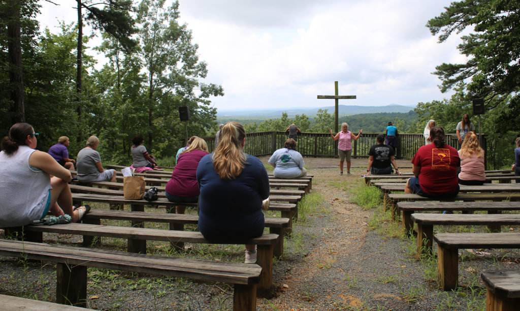 "Camp Mundo Vista's outdoor chapel offers a panoramic view of North Carolina's Uwharrie Mountains.  ""We're on this beautiful mountaintop,"" retreat participant Martha Knight said.  ""You just feel so immersed with God out here."""
