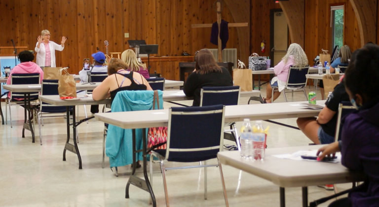 "Mary Gray leads a Bible study session for this year's Military Wives Retreat. . ""This year, God laid it on my heart to really talk about the power we have in prayer,"" she said."