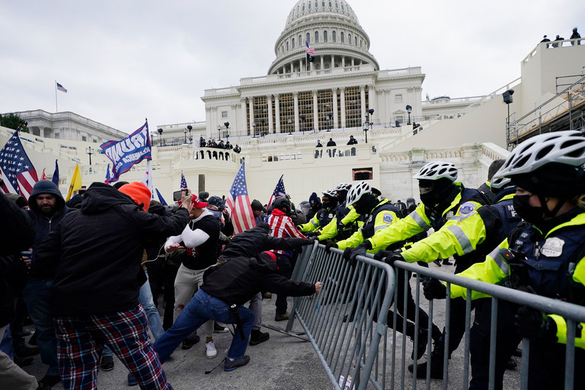 Trump supporters try to break through a police barrier Wednesday at the Capitol in Washington. As Congress prepared to affirm President-elect Joe Biden's victory, thousands of people gathered to show their support for President Donald Trump and his unsubstantiated claims of election fraud. One person was shot during the violence and died.