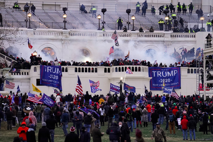 Violent protesters, loyal to President Donald Trump, storm the Capitol, Wednesday, Jan. 6, 2021, in Washington. It's been a stunning day as a number of lawmakers and then the mob of protesters tried to overturn America's presidential election, undercut the nation's democracy and keep Democrat Joe Biden from replacing Trump in the White House. (AP Photo/John Minchillo)