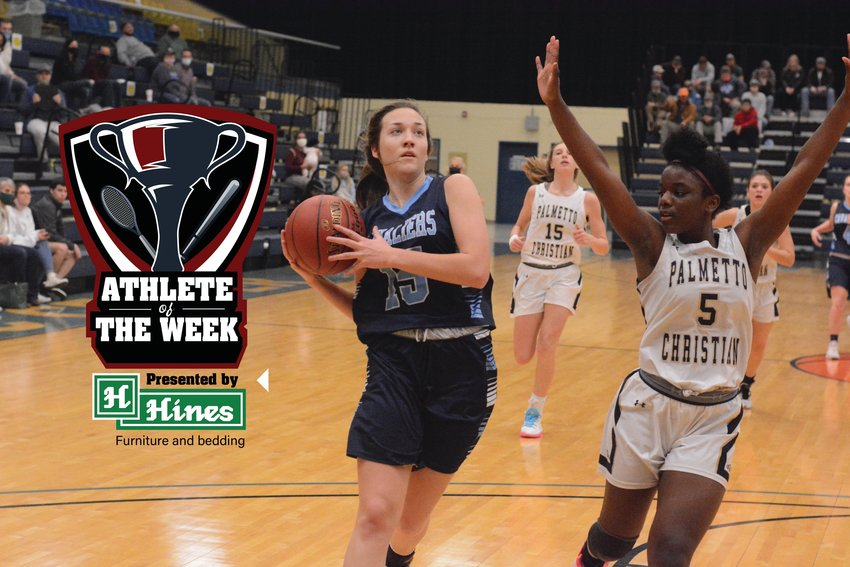 Lee Academy's Caleigh Barrett (15) won the Hines Furniture Athlete of the Week after scoring her 1,000th point in a win over John Paul II on Friday.