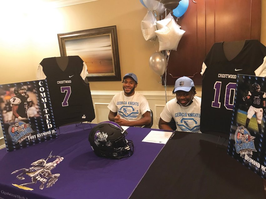 Crestwood's Tony Raymond, left, and Desmond McMillan share a smile after they signed to play football with Georgia Knights Prep Academy, a prep school in Snellville, Georgia.