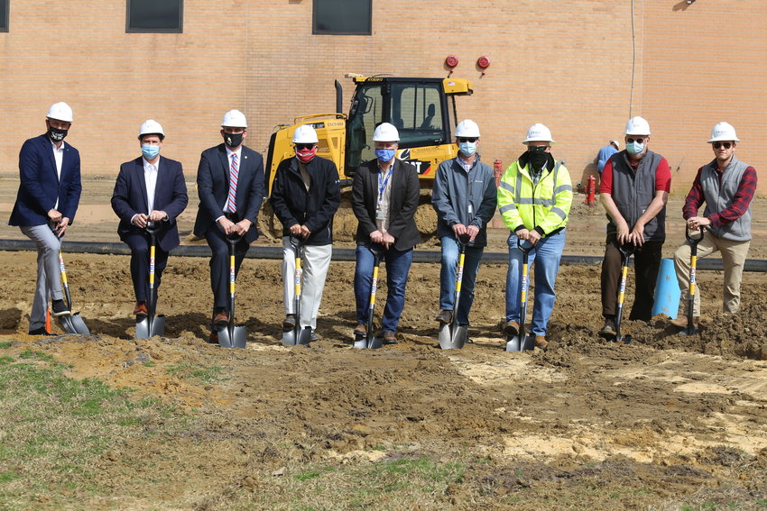 Various local officials, BD management staff and Hogan Construction officials take part in Wednesday's groundbreaking ceremony for Phase 2 of the local manufacturer's current expansion project.