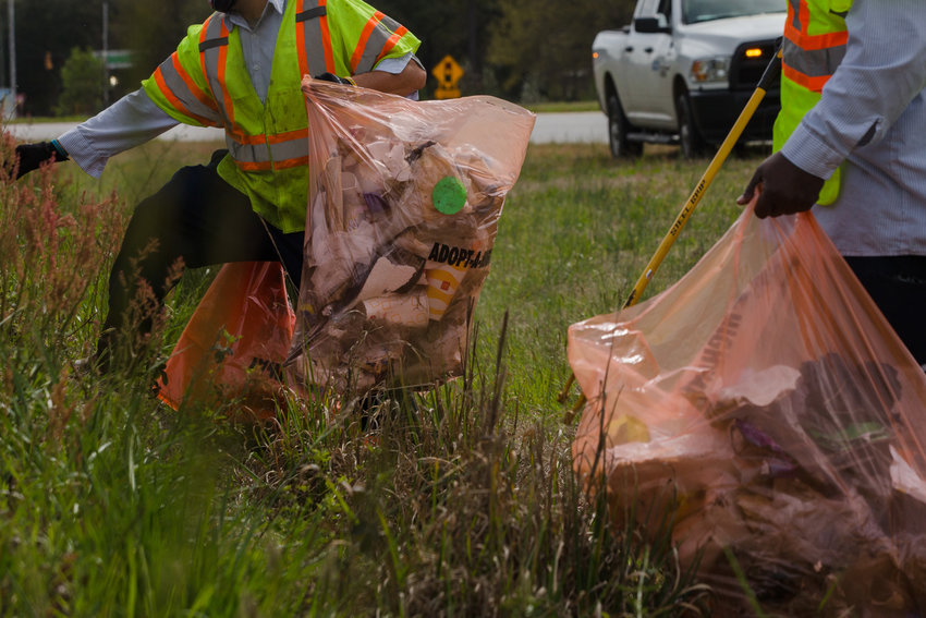 Travis Jenkins and Douglass Ledwell, with the South Carolina Department of Transportation, cleans up litter on the side of Highway 378 recently.