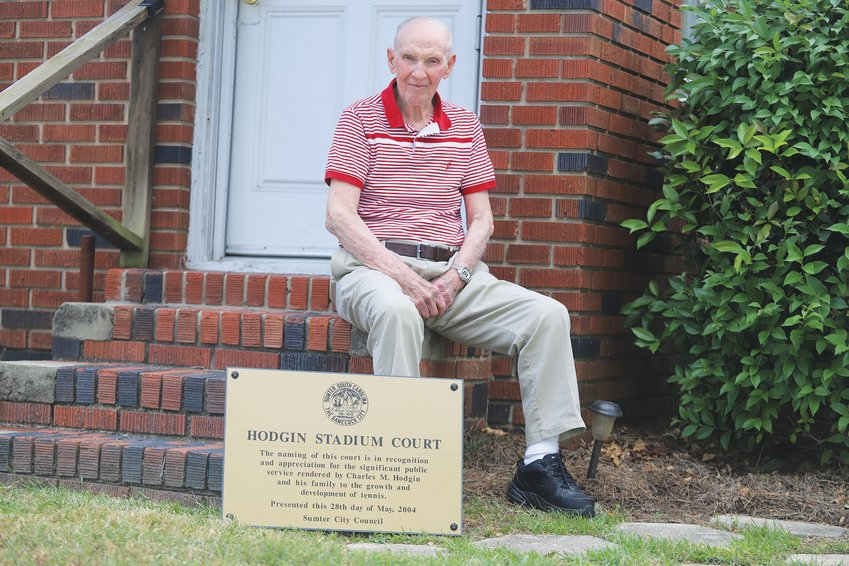 Charles Hodgin sits with the plaque he received when the main court at Palmetto Tennis Center was named Hodgin Stadium Court when the facility opened in 2004. Hodgin was inducted into the South Carolina Patrons Tennis Hall of Fame in December 2019.