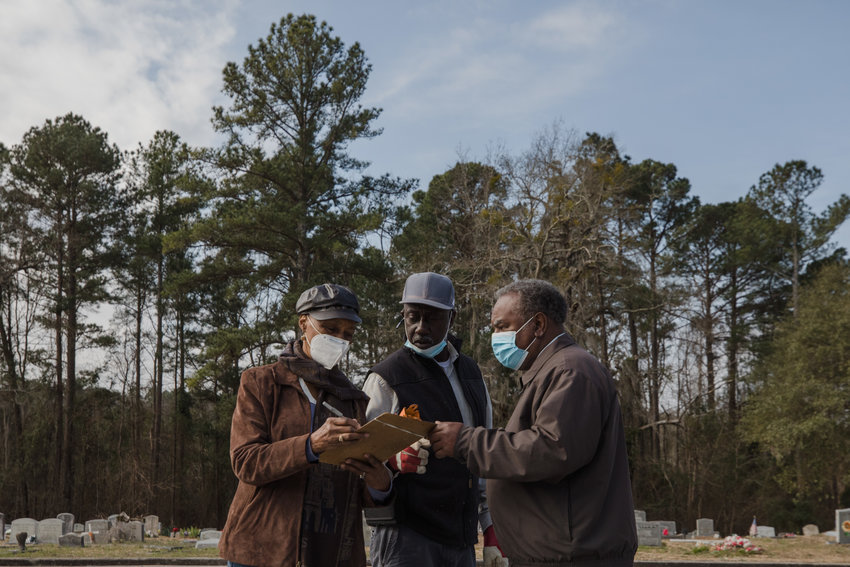 Volunteers wear masks during a U.S. Department of Agriculture food distribution event at Wayman Chapel AME Church in Sumter recently.