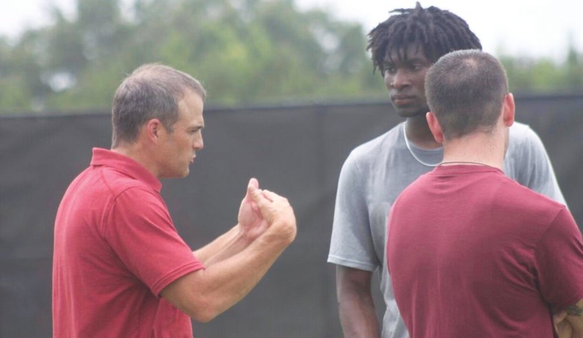 Clarendon Hall's Kylic Horton, right, speaks with South Carolina head coach Shane Beamer at a camp at USC in early June. Horton left the camp with a scholarship offer.