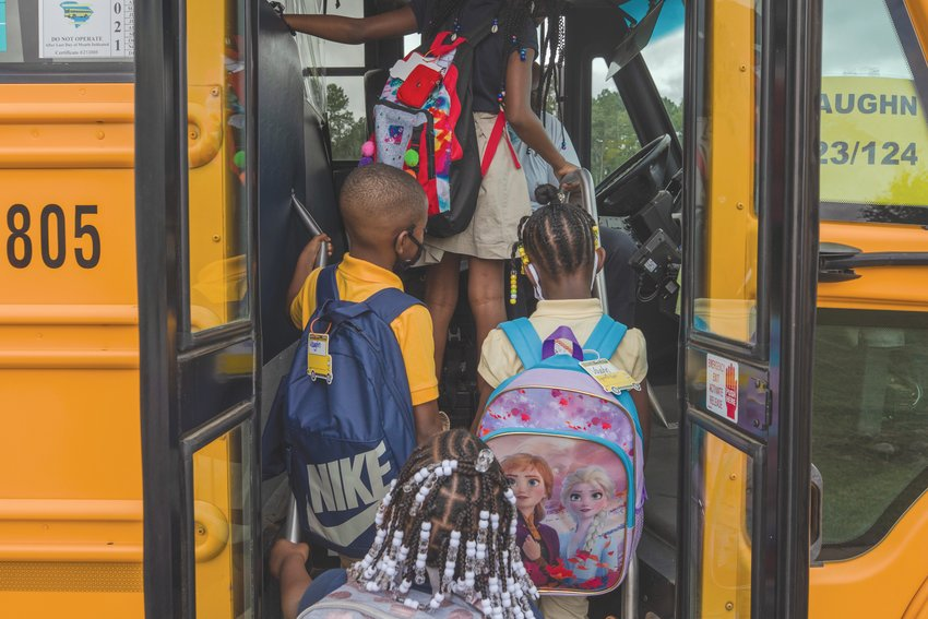 Students at R.E. Davis Preparatory Academy prepare to leave after the first day of school on August 17, 2021.