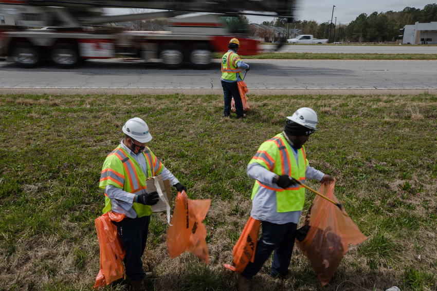 Travis Jenkins, Douglass Ledwell and Calvin Blair, with the South Carolina Department of Transportation, clean up litter on the side of U.S. 378 in March.