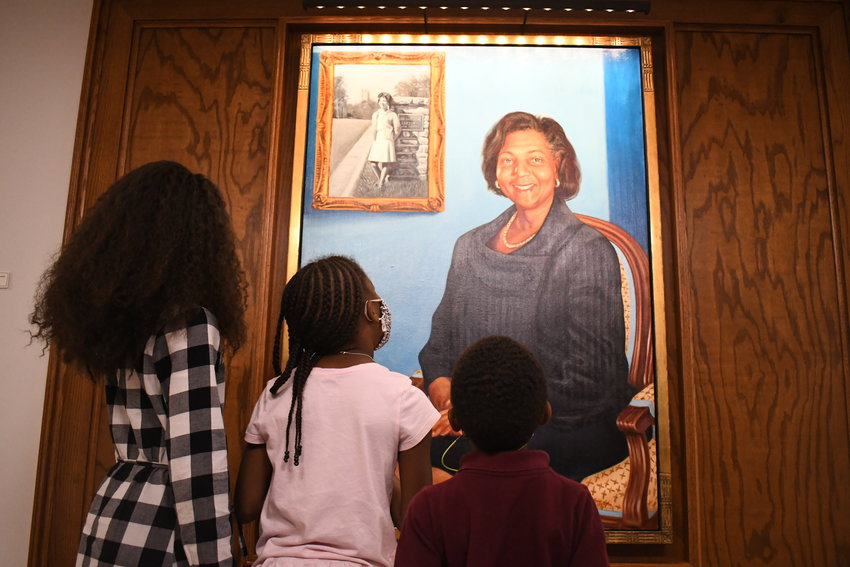 """Children look at the portrait of Wilhelmina """"Mimi"""" Reuben-Cooke inside the Wilhelmina Reuben-Cooke Building at Duke University on Saturday after a formal ceremony to dedicate the building in Reuben-Cooke's honor."""