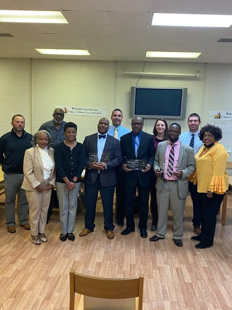 Clarendon School District 4 Board of Trustees pose with the district's five principals as they are honored for October's Prinicpal Appreciation month on Monday.
