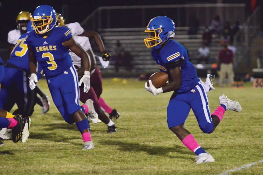 Scott's Branch running back Tyler Kind, right, carries during a 51-0 loss to C.E. Murray on Friday.