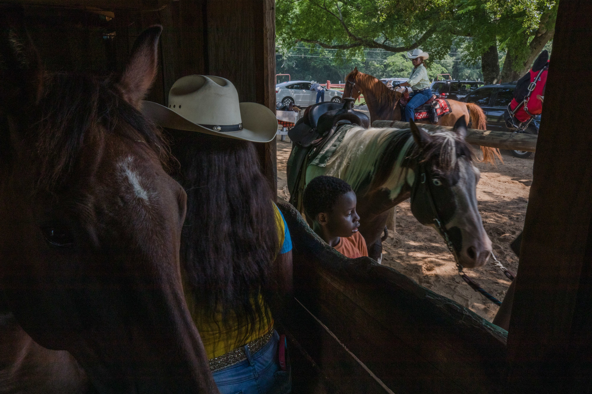 Members of the Black Cultural Enlightenment Society and of the Myers family prepare for the 23rd annual Black Cowboy Festival and Rodeo at Greenfield Farms on Saturday. Greenfield Farms sits on land that Sandra Myers' family once sharecropped and in 1991 Sandra and Mark, her husband, bought the land back. The festival, which is one of the only of its kind in the country, has happened almost every year since. For more information or to purchase a ticket go to www.blackcowboyfestival.net or call (