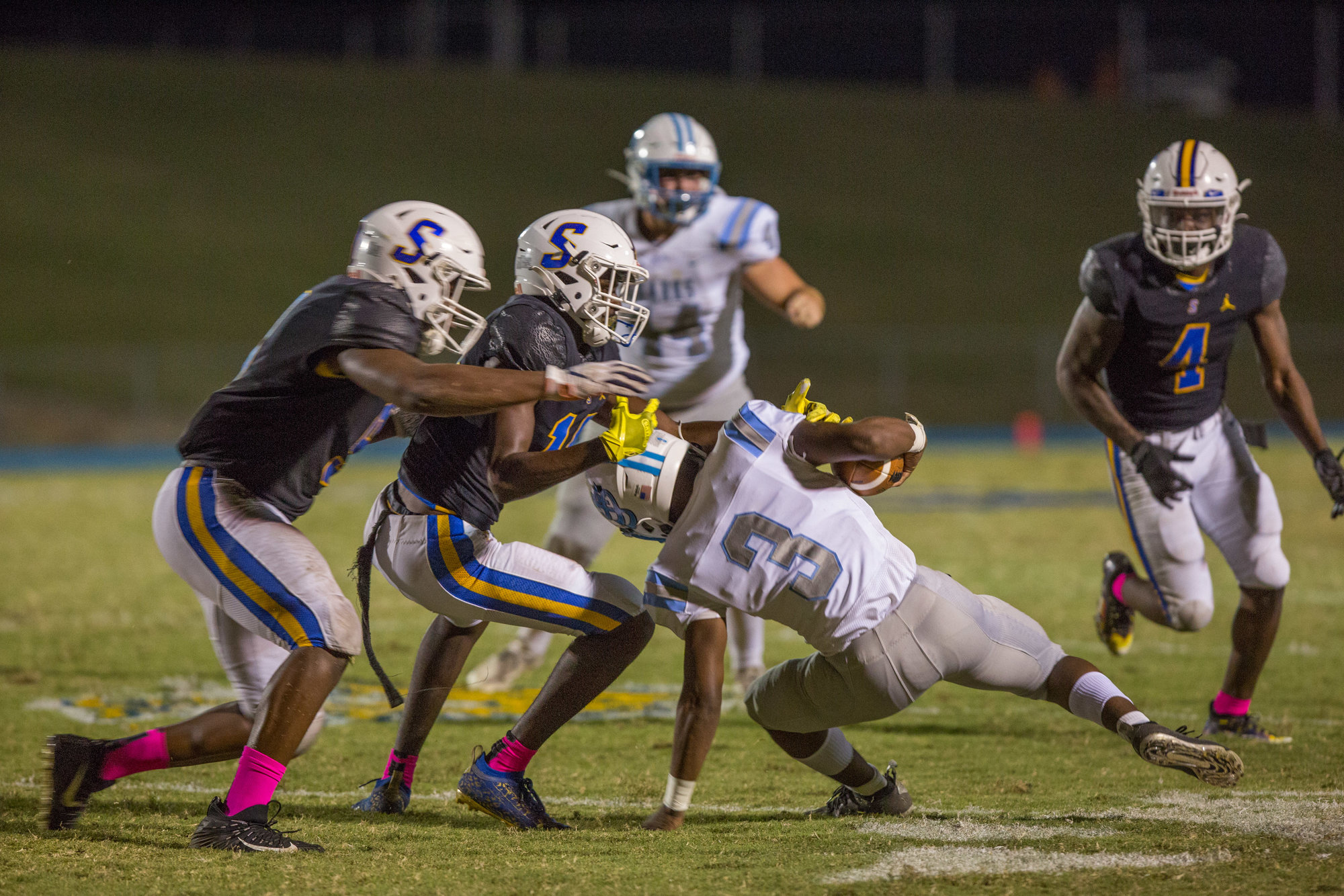 Sharks, Jasaan Faulkner, being taken down by Gamecocks defense. The Sumter High School, Gamecocks, take down St. James, Sharks, in a final score of 24-7 in Friday night's game on Oct. 22, 2021.