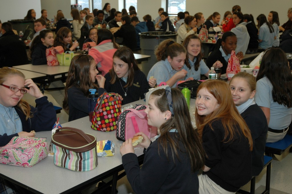 ABUNDANT BLESSINGS: Students enjoy their lunch in the cafeteria of their new school, Immaculate Conception Catholic Regional, above.