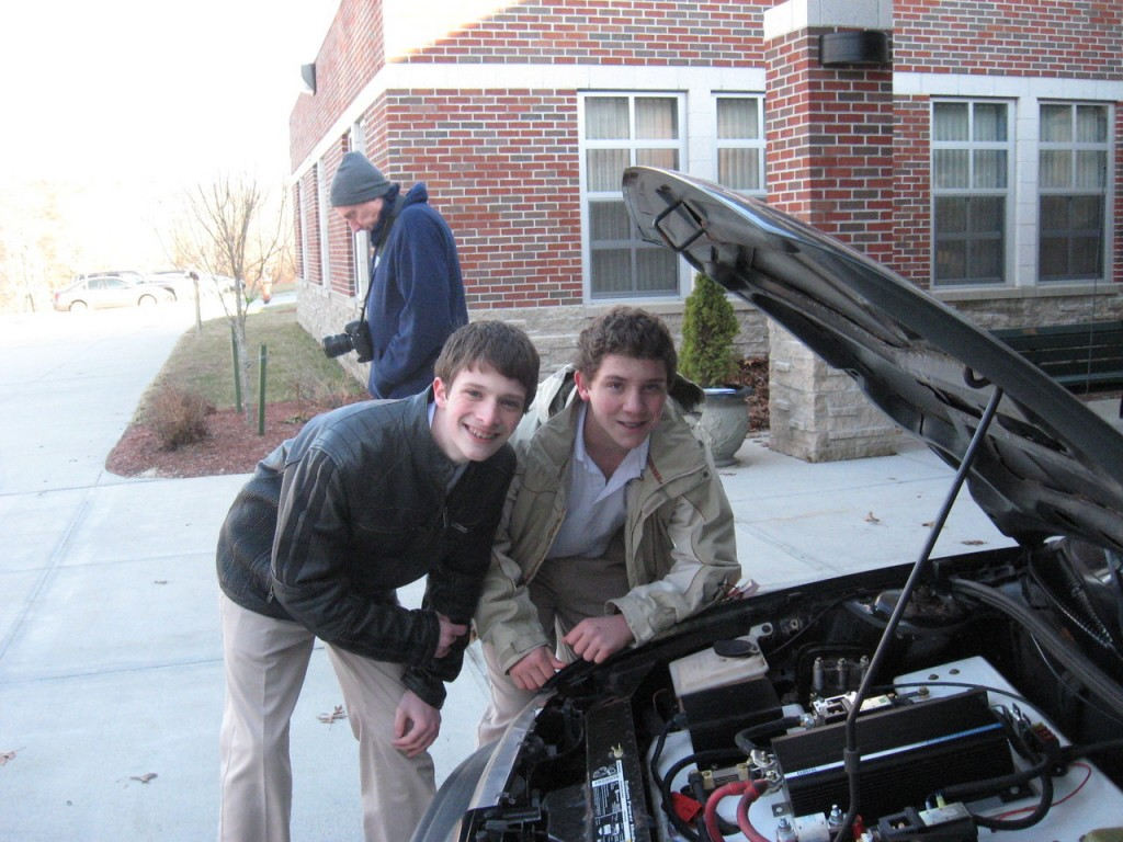 ELECTRIC CONVERSION:  Mercymount Country Day School seventh graders Jarred Lorusso (left) and Patrick Collins recently converted a 1997 Saturn to electric power as part of a classroom science project.