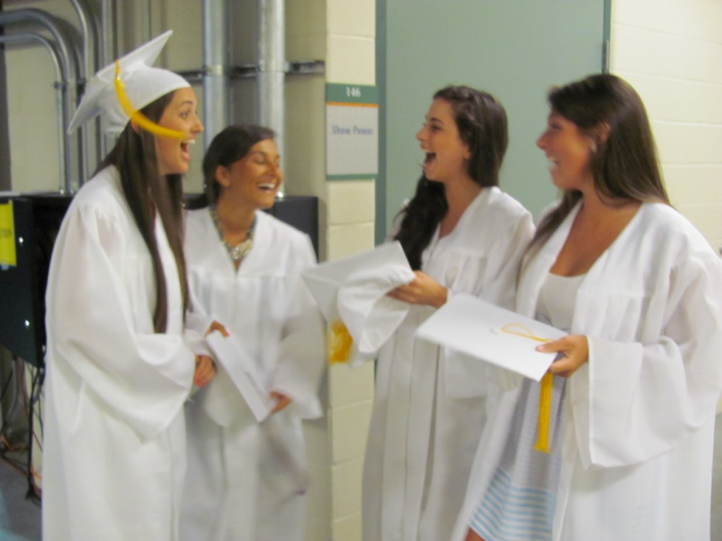 LOOKING TO THE FUTURE: Classmates, from left to right, Courtney Jennings, Amanda Notarianni, Keely Scowcroft and Adele Huffine reminisce before the exercises.