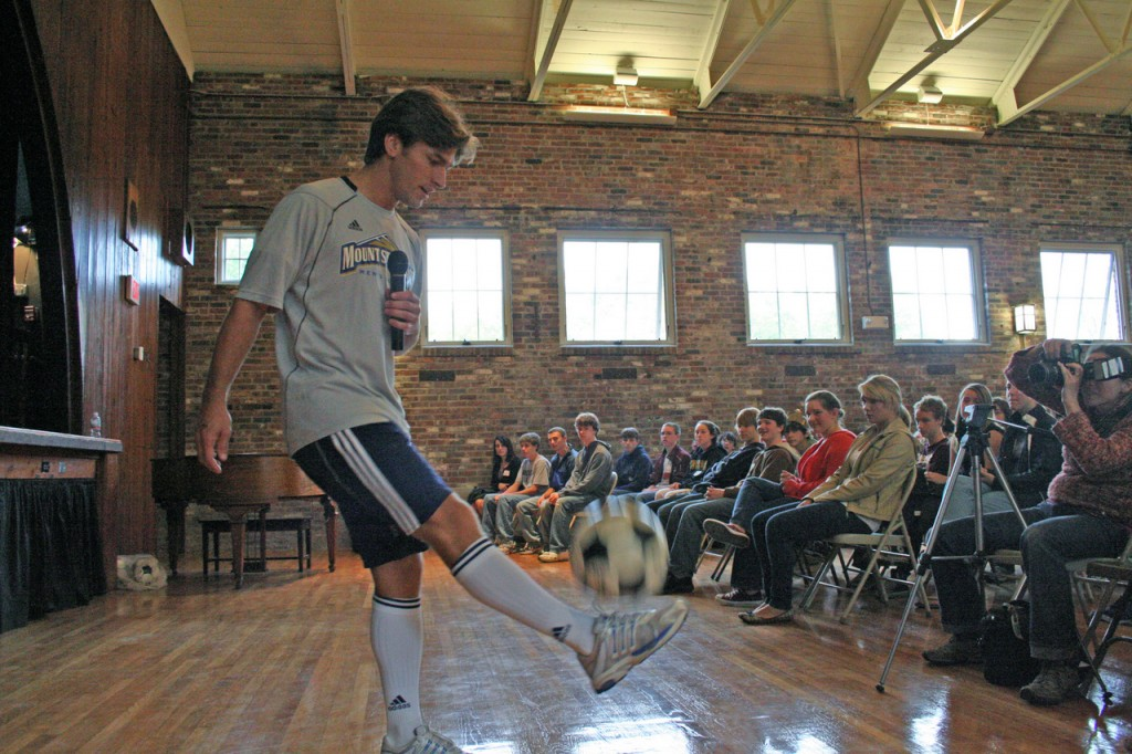 SPIRITUAL ATHLETE: Chase Hilgenbrinck shows off his soccer skills to the confirmation students at their retreat at St. Francis of Assisi Church, Wakefield. Hilgenbrinck shared with teenagers that many of the skills he learned through his years as a professional soccer player have helped him in his transition into seminary life and helped to form him into a stronger Catholic.