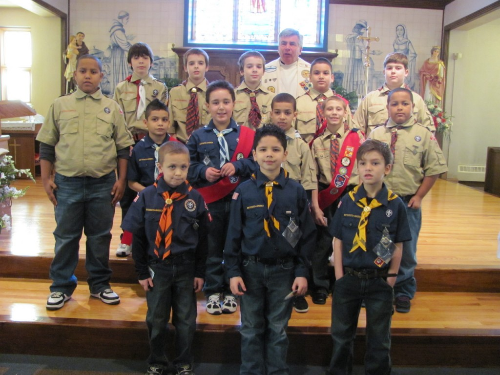 BOY SCOUTS: Pack 76 of St. Anthony Church celebrated Scout Sunday with a Mass with Father Charles H. Galligan, pastor St. Edward Church, Pawtucket, as the celebrant. After the homily, Father Galligan presented the Parvuli Dei award to the scouts. The Parvuli Dei award is presented to boys who explore a wide range of activities in order to discover the presence of God in their daily lives and also to develop a good, positive self-image through the contributions they can make to the group or community.