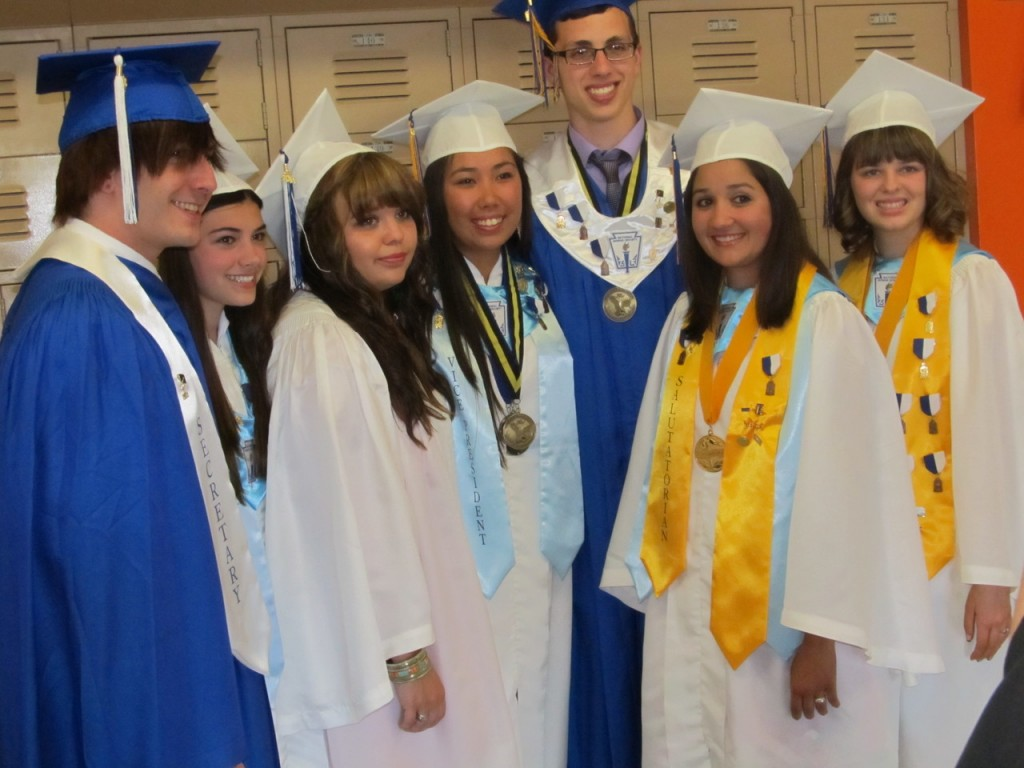 FATIMA GRADUATION: From left, Andrew Bretz, Rebecca Aubin, Audrey Collins, Victoria Harris, Eric Norman, Megan Silva and Emily Mercer gather before processing into the gymnasium for graduation exercises.