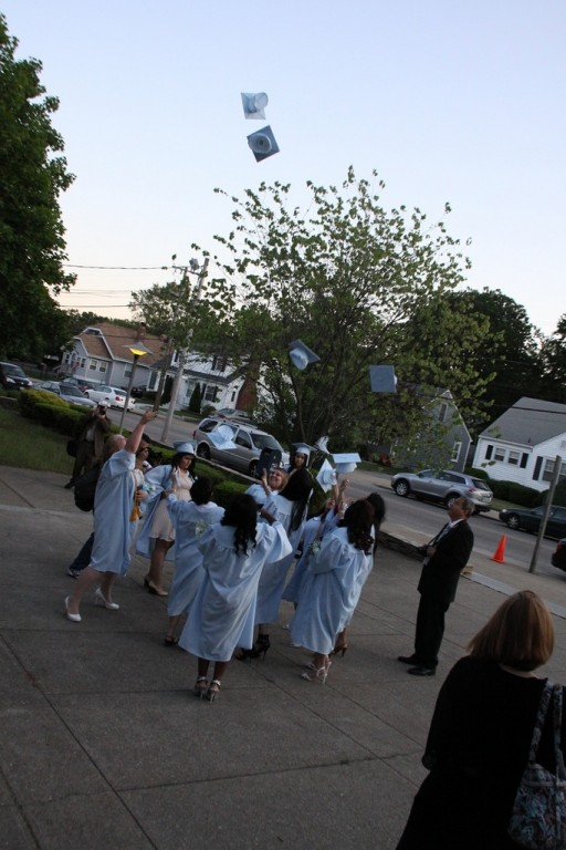 CAPS OFF: Graduates of Bishop Keough High?School toss their caps in the air in celebration after their graduation ceremony at Saint Maria Goretti Church, Pawtucket, on?Friday, June 3.