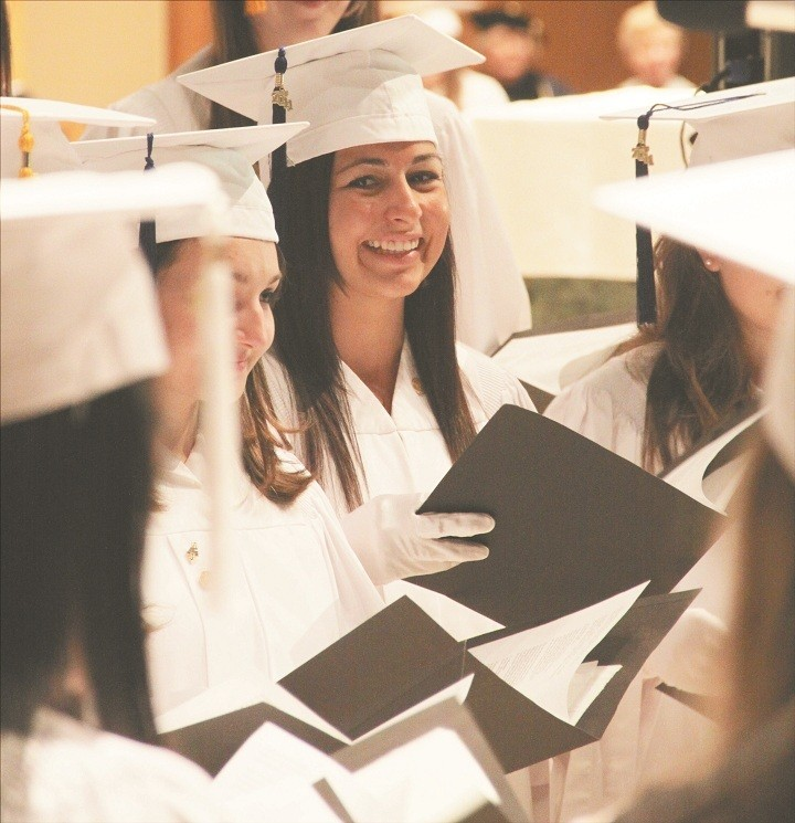 PROUD MOMENTS: Elia Nappa and other Bay View Choral singers, raise their voices during a graduation medley.
