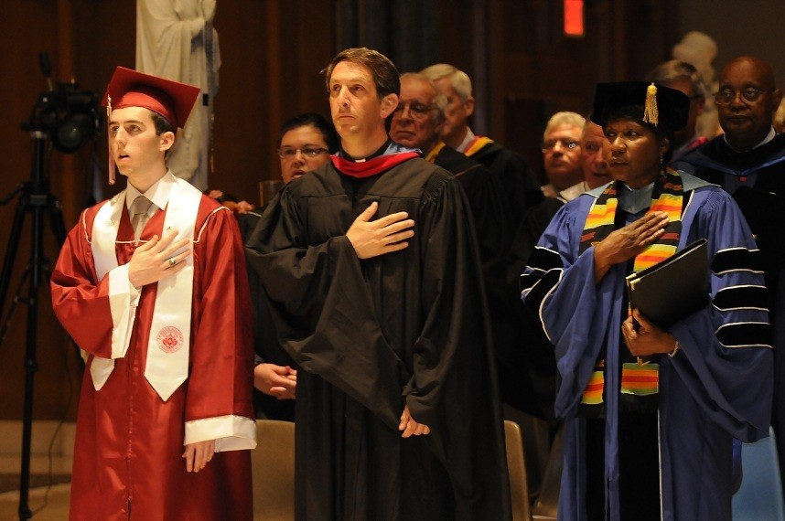 ACADEMIC EXCELLENCE:  Senior Ryan Sweeney,?Father Michael Najim, chaplain of La Salle Academy, and Dr.?Wanda Ingram during the graduation.?Ryan gave the welcoming address for the Class of 2011.