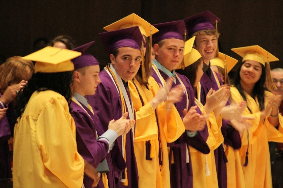 PEER PRAISE: Valedictorian Gregory Jude Pereira, third from left, receives applause from his peers after delivering his address at graduation.