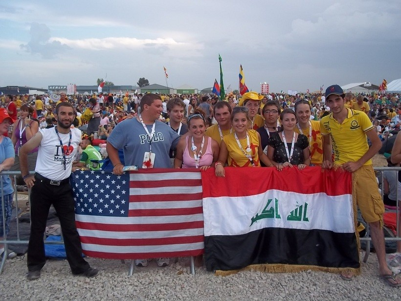 MOVING DAY: Local pilgrims are inspired after meeting two peers from Iraq while waiting for the pope at World Youth Day. Between the Iraqis, from left, are: Joey Burns, Alex Rizzini, Katie Ouellette, Steven Ouellette, Sophia Andreadis, Nicole Stone, Anthony Rezendes, Aryn Pryor, Mary Houser. Stone and Houser are consecrated women of Regnum Christi who joined the group on their pilgrimage.