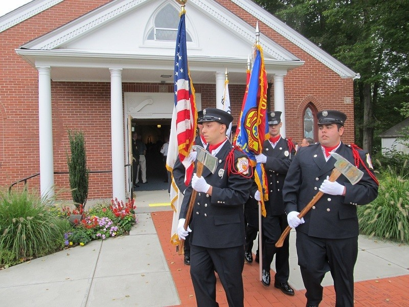 REMEMBERING: Members of the Gloucester Fire Department Honor Guard lead the procession out of St. Eugene Church following the Memorial Mass honoring the victims of Sept. 11, 2001 and paying tribute to police, firefighters and rescue personnel.