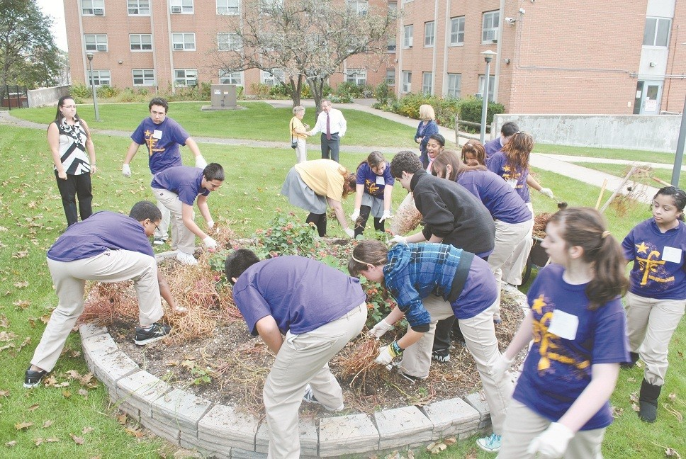 COMMUNITY SERVICE: The freshmen class of Saint Raphael Academy, Pawtucket, recently participated in a Faith, Service and Community Day. The day began with a prayer service at which president/principal, Maryann Donohue-Lynch spoke about Lasallian ministries worldwide, and senior, Brenden Knight spoke about service and his experiences in Lasallian Youth. The students then volunteered at the Pawtucket YMCA, Heritage Park Child Care Center, Fogarty Manor, the Pawtucket Soup  Kitchen, and Darlington Assisted Living.