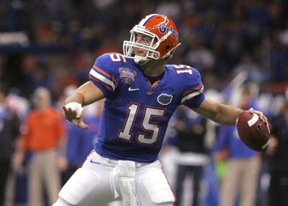 FAITHFULLY PROUD: Then University of Florida quarterback Tim Tebow looks to throw a pass during the NCAA Sugar Bowl football game in New Orleans last year.  In a league known for star players who become infamous for scandal and sexual promiscuity, Tebow's story is a welcome refuge from stories that normally dominates the NFL.