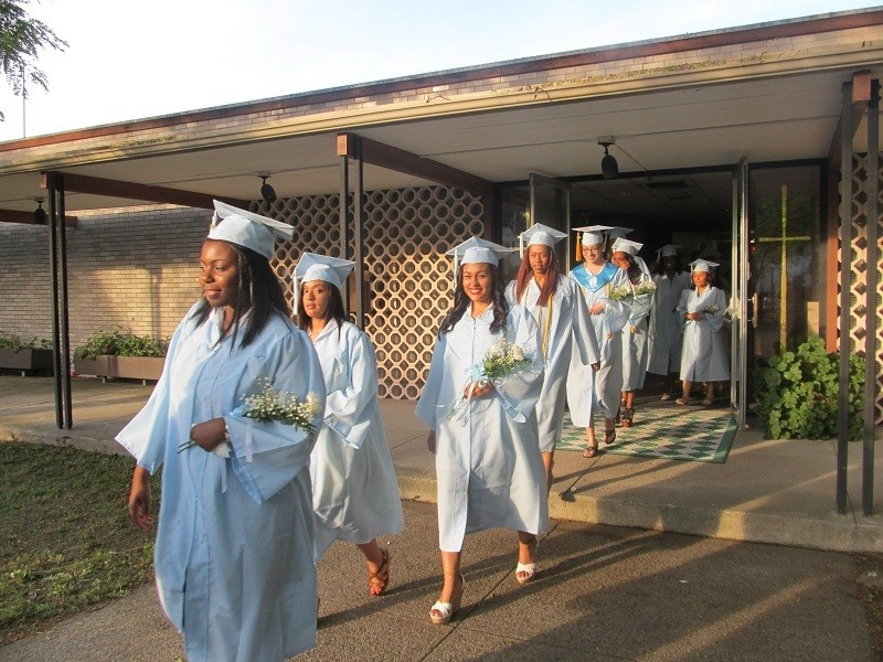 PROUD NIGHT: Members of Bishop Francis P. Keough Regional High School's Class of 2012 march from the school to St. Maria Goretti Church where commencement exercises were held last Friday night.