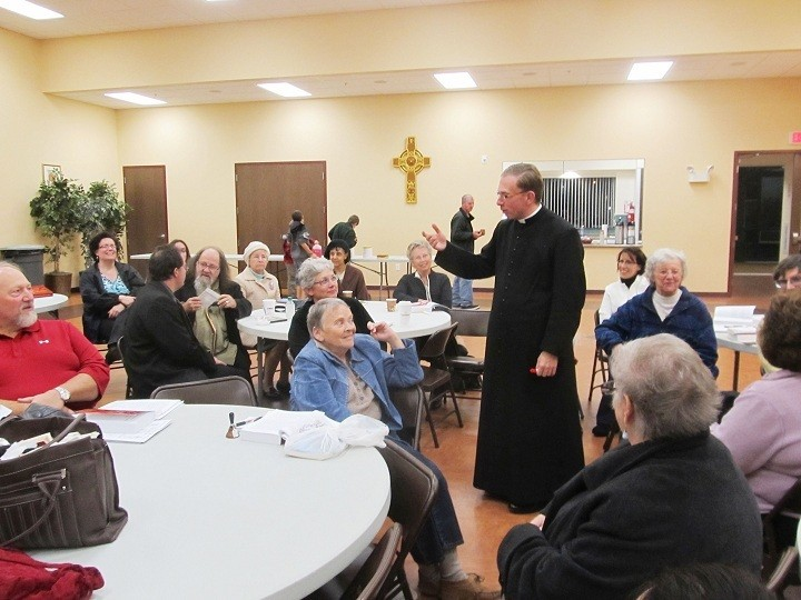 CONTINUING EDUCATION: Father Derek Puleo, assistant  pastor of SS. John and Paul Parish, Coventry, instructs parishioners attending the Year of Faith adult education series that focuses on the Catechism of the Catholic Church.