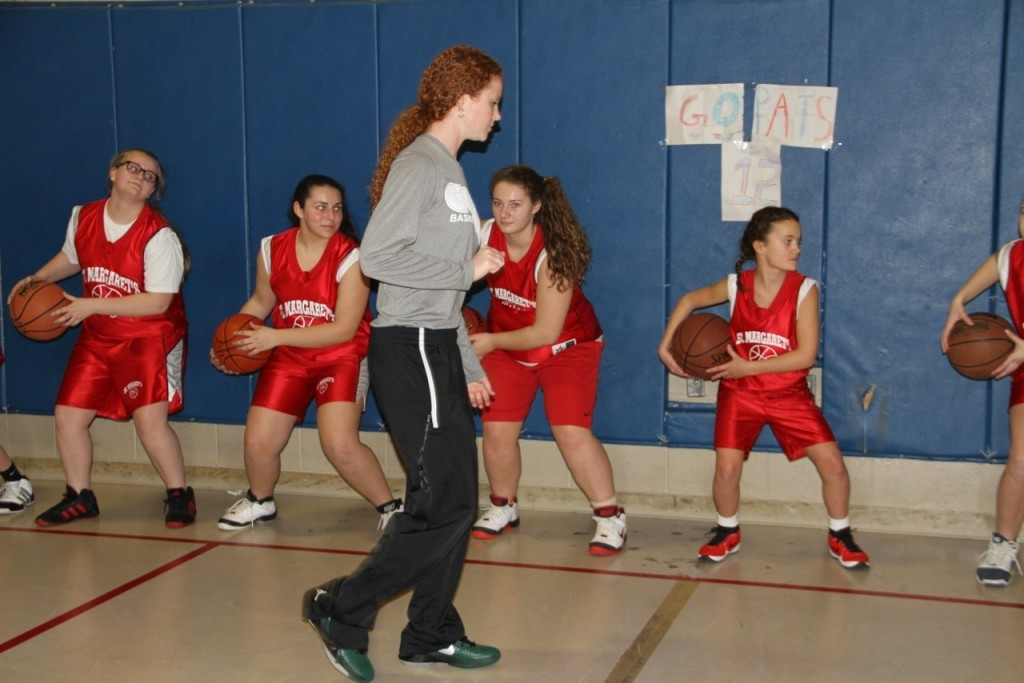 TEAM: Coach Kate Lynch leads the St. Margaret Catholic Athletic League girls basketball team in drills. Lynch, who was inducted into the St. Margaret Hall of Fame in 2011 returned to her alma mater for a special practice.