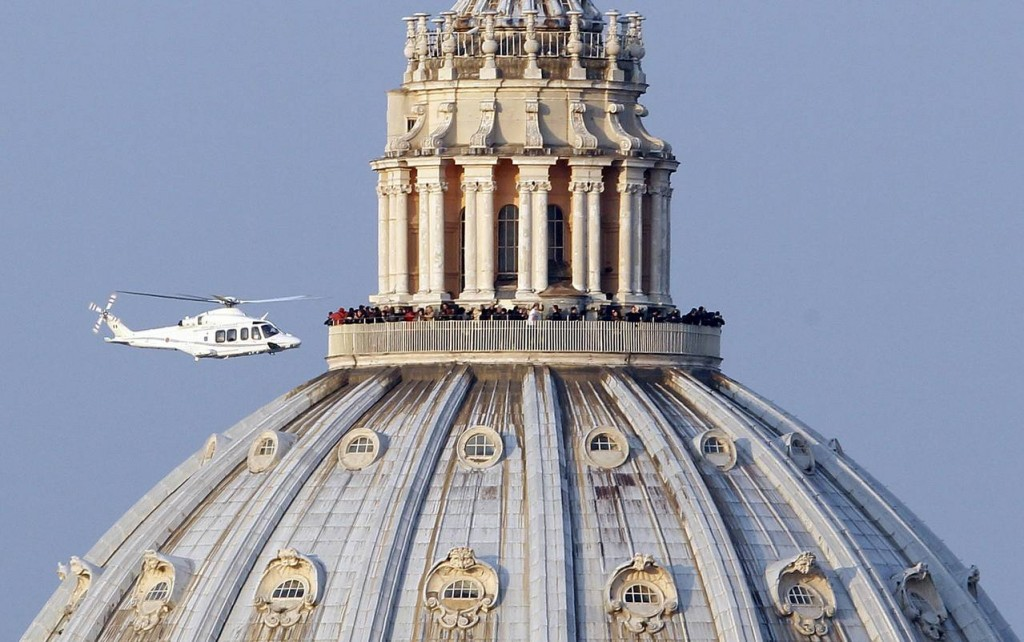 "The helicopter carrying Pope Benedict XVI flies past St. Peter's Basilica as it leaves the Vatican for Castel Gandolfo, Italy, Feb. 28. ""I am a simple pilgrim who begins the last stage of his pilgrimage on this earth,"" the pope said at the close of his papacy."