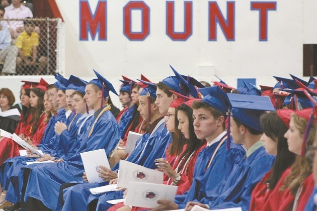 GRADUATION DAY: Graduates listen to their fellow classmates share words of gratitude with their parents, teachers for the education they received at Mount Saint Charles Academy in Woonsocket.